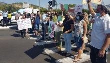 Social workers block traffic at the Mahanaim Junction in the Upper Galilee on Monday morning, July 13.
