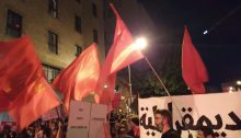 Red flags aloft in Jerusalem's Paris Square Saturday night, August 1, near the official residence of Prime Minister Benjamin Netanyahu whose resignation the protestors called for.