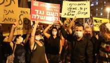 "MK Ayman Odeh participated in the demonstration at Jerusalem's Paris Square Saturday night, August 1, near the official residence of Prime Minister Benjamin Netanyahu whose resignation the protestors called for. The printed red Hadash placard reads"" When the government is against the people, the people are against the government."" The hand-written sign held aloft by Odeh satirically synthesizes government pronouncements: ""Current status: 16 year old leftist anarchist is spreading diseases."""