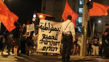 "Hadash and Communist Party of Israel activists participated in the demonstration at Jerusalem's Paris Square, last Saturday night, August 1, near the official residence of Prime Minister Benjamin Netanyahu whose resignation the protestors called for. The Arabic and Hebrew banner reads ""Democracy for All."""