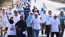 The Mothers for Life Movement march, Saturday, August 15, near Neve Shalom – Wahat al-Salam. Among the marchers were MK Ayman Odeh (center with walking stick) and other Hadash activists.