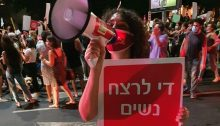 "Noa Levy, a member of the Communist Party of Israel's Central Committee during the protest held in Tel Aviv, August 23, 2020. The placard she's holding reads ""Enough murder of women."""
