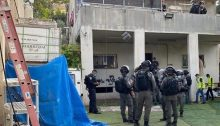 Israeli Border Police deployed to secure the site congregate outside the home in which the Tahan family resided for nearly 30 years in the occupied East Jerusalem neighborhood of Silwan in preparation for its demolition, August 11, 2020.