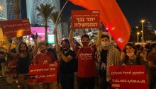 "Young communists are among the hundreds who blocked Begin Road in Tel Aviv, Thursday evening, August 27. The Hadash placard held aloft in the center of the picture reads: ""Salaried workers, independents and unemployed together against the government."" The Hebrew-Arabic signs read ""Bibi / Netanyahu is good for the rich."""