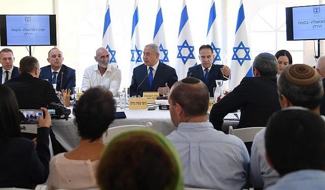 Prime Minister Benjamin Netanyahu leads his cabinet's weekly meeting in the presence of settlers in the occupied Jordan Valley, September 15, 2019.