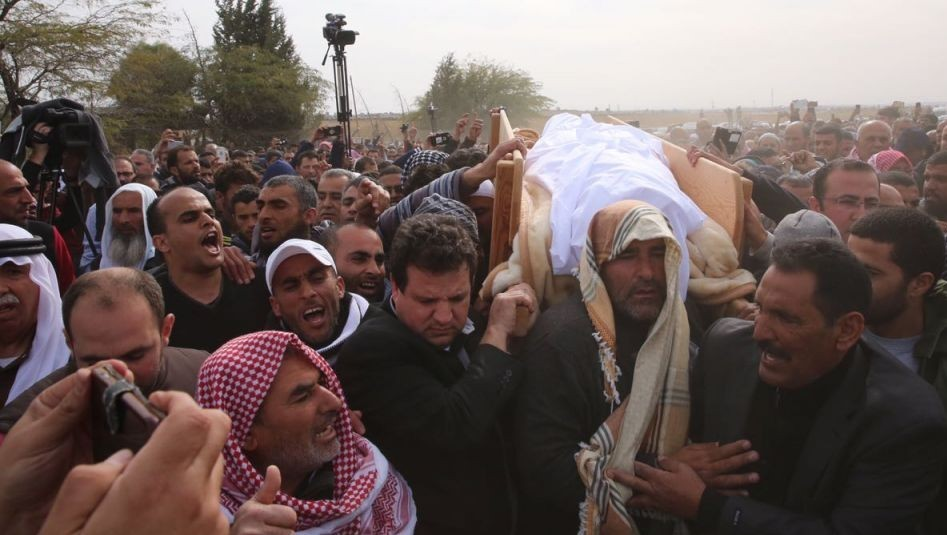 "Joint List chairman MK Ayman Odeh (Hadash) was among the pallbearers carrying the body of Yaqoub Musa Abu al-Qee'an to his grave on January 24, 2017, near the village of Umm al-Hiran. Contrary to Muslim tradition requiring immediate burial of a corpse, the funeral was delayed by nearly a week as Israel's Police Force refused to release al-Qee'an's body as part of its punishment for the alleged ""terrorist's"" family."