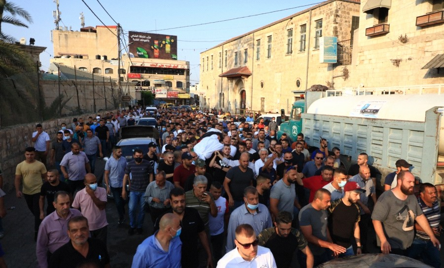 Hundreds accompany the body of Dr. Nidal Jabareen, 54, to burial hours after he died from a heart attack on Friday, September 18, when an Israeli soldier fired a concussion grenade at him.