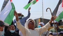 Palestinians protest on September 12 against Israeli occupation and colonization at the entrance to the occupied West Bank village of Hares. Weekly protests have been held in Hares since May, following an incident in which settlers destroyed hundreds of trees on land belonging to residents. Each week, soldiers close the gate to the village, preventing residents from marching to their land.