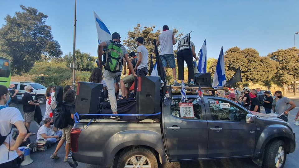 Demonstrators preparing to deploy themselves along a major highway leading to Jersusalem to conduct a protest against Prime Minister Benjamin Netanyahu, Thursday, September 24