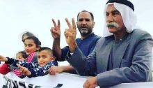 Sheikh Sayekh Abu Madi'am al-Touri, right, and family members during a demonstration against the demolition of the Bedouin village of Al-Araqib, unrecognized by the State of Israel