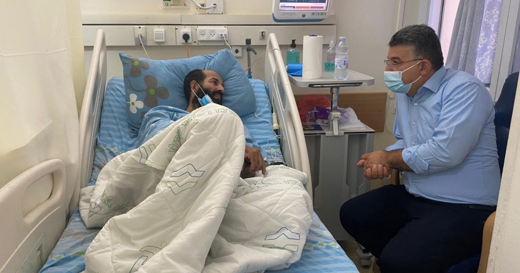Hunger-striking Maher Al-Akhars converses with MK Youssef Jabareen during a visit by the latter at the Kaplan Medical Center in Rehovot, October 6.