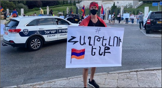 "Ethic Armenian citizens of Israel demonstrate in Haifa, October 2, 2020, calling for a cease-fire in the fighting in Nagorno-Karabakh and an end Israel's arms sales to Azerbaijan. The placard implores ""Don't abandon Armenia."""