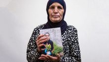 Ranah al-Hallaq, the mother of Iyad, the Palestinian man with autism who was killed by a Border Police officer, holds up a photo of her son, June 2, 2020.