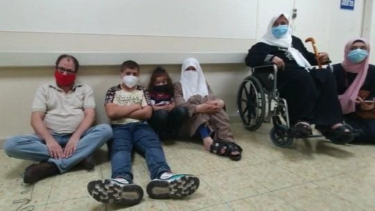 MK Ofer Cassif, left, and Maher al-Akhras's family during their solidarity hunger strike outside the room where the Palestinian prisoner is being detained at the Kaplan Medical Center in Rehovot