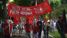 "Young communists demonstrate in the anti-Netanyahu protest on Rothschild Boulevard in Tel Aviv, last Saturday, October 31. The banner reads in Hebrew: ""Against the Rule of Capital and for Democracy for Everyone."""