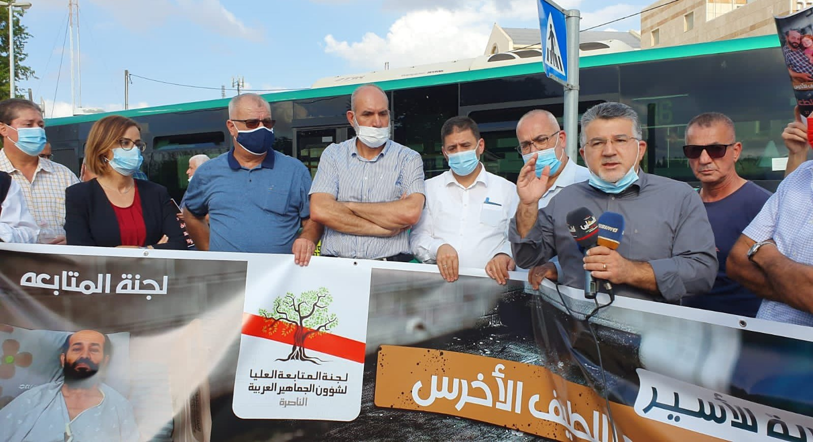 Hadash MK Yousef Jabareen (Joint List) speaks at the solidarity demonstration outside the Medical Center in Rehovot where the Palestinian prisoner Maher al-Akhras is being detained, Tuesday, November 3. The signs behind which the demonstrators are standing display the name of the High Follow-Up Committee for Arab citizens of Israel.