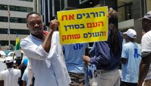"Sudanese asylum-seekers demonstrate in Tel Aviv in solidarity with the popular ongoing struggle for democracy in their country, June 2019. The sign in Hebrew held aloft reads ""They're killing the people in Sudan and the world remains silent."""