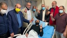 Parliamentarians from the Joint List and former MK Mohammed Barakeh (third from left) gather in Palestinian detainee Maher al-Akhras's room at Kaplan Hospital in Rehovot, on November 6, 2020 to wish him well on the end of his hunger strike.