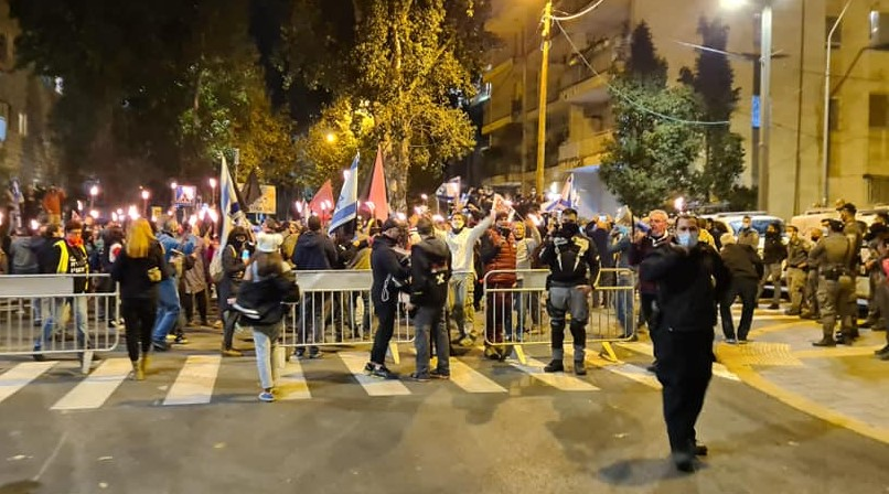 Police barricades block the progress of protesters as they approach the PM's official residence in Jerusalem, Saturday night, December 13, 2020.