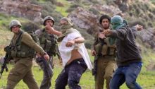"Israeli settlers from a ""wildcat outpost"" attack Palestinians in the occupied West Bank while soldiers merely look on."