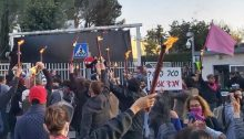 "Several hundred people protest outside the compound housing far-right Prime Minister Benjamin Netanyahu's official residence on Balfour Street in Jerusalem, Saturday, December 27. Note the black curtain that had been erected behind the entrance gate which protestors called to bring down. The small sign in center right reads: ""Private lockdown? Civil rebellion!"""