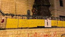"The second Christmas tree to be burned outside the Catholic church in Sakhnin this week; the graffiti sprayed in red paint on the stone wall reads: ""Only Allah's Messenger Mohammed."""