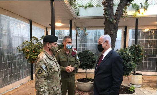 An obviously relaxed and confident Prime Minister Benjamin Netanyahu confers with the US Chairman of the Joint Chiefs of Staff Gen. Mark A. Milley, December 19, 2020. In the center is the Israel military's Chief of Staff Lt. Gen. Aviv Kochavi. Even the mask can't hide Netanyahu's satisfaction. Woe to us all if Israel's arrogant and corrupt prime minister gets his way in the end.