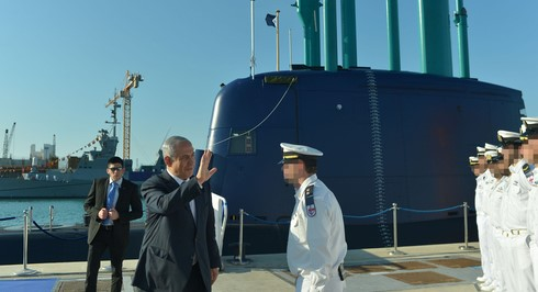 Prime Minister Benjamin Netanyahu welcomes a new submarine to the Israeli Navy fleet at a ceremony in Haifa in 2016.