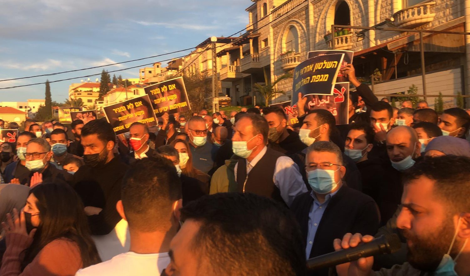 Hundreds of protestors marched in Umm al-Fahm a day after the serious wounding of the former mayor of the city, Dr. Suleiman Aghbariah, on Thursday, January 7. Among the protestors was Hadash MK Youssef Jabareen (second from right, wearing glasses) a resident of the city.