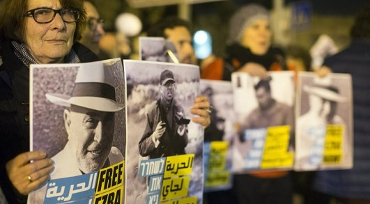 Peace activists protest outside the Russian compound police station in Jerusalem, calling to release the three anti-occupation activists then under arrest there: Ezra Nawi, Guy Butavia and Nasser Nawaja, January 21, 2015.