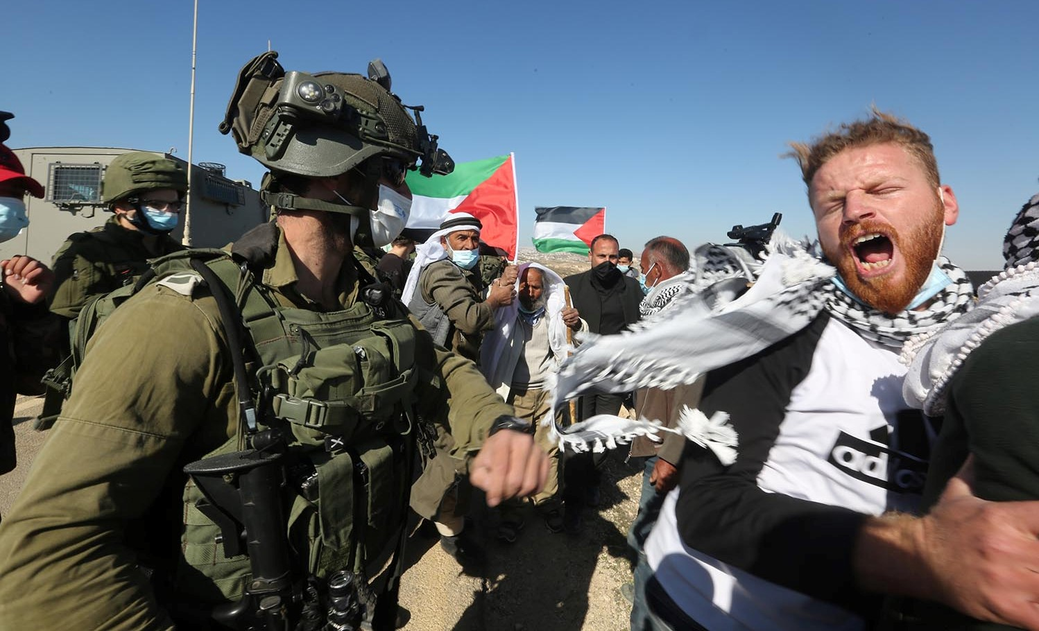 Israeli occupation forces confront protestors during a protest last Friday, January 8, in the village of Al-Rakeez where Haroun Abu Aram, 24, was shot at point blank range when he tried to recover a generator confiscated by soldiers.