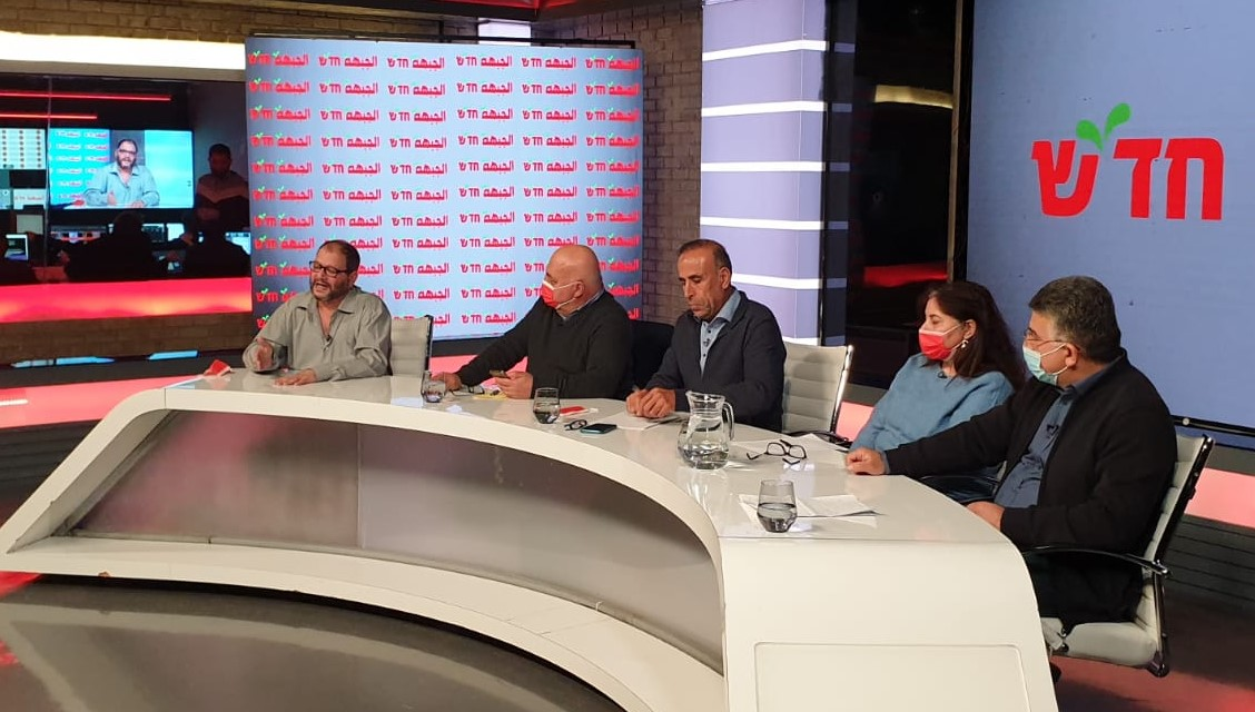 MKs Ofer Cassif (first from left) and Youssef Jabareen (first from right) during the electoral council of the Democratic Front for Peace and Equality (Hadash – Jabha) held last Saturday evening, January 16, 2020; in the center of the dais from left to right are the Chairperson of Hadash and former MK Dr. Afu Aghbaria, Secretary General of Hadash Mansour Dehamshe, and Member of the Hadash Secretariat Indiah Sagheir.