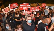 """Actors and theatre workers protest near the Prime Minister's office in Jerusalem, August 2020; among the signs: """"This stage must not be left empty,"""" """"Bibi, Open the theatres."""""""
