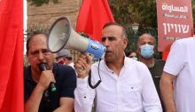 """Hadash's Secretary General Mansour Dahamsheh, during a demonstration in front of the Knesset, Jerusalem, May 20, 2020: """"There will be no Joint List with four parties. The negotiations are over. The placard in the background reads: """"Equality and nothing less."""""""""""