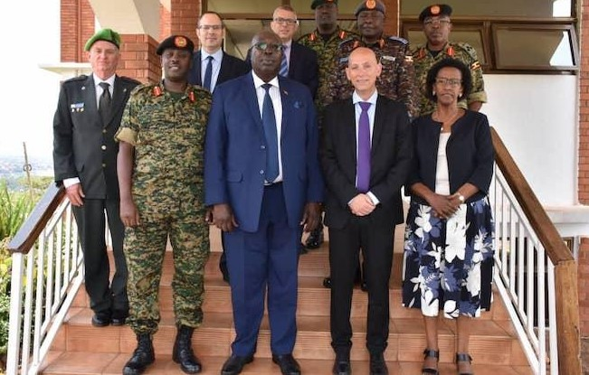 A delegation of Israel's Ministry of Defense, led by the head of the International Defense Cooperation Directorate (SIBAT) Brigadier General (ret.) Michel Ben-Baruch, (second from right in first row) during a visit to Uganda, May 2019