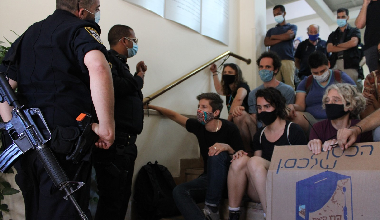 Peace activists blocked the main entrance of the JNF offices in Jerusalem in August 2020, to protest the pending eviction of members of the Palestinian family Sumarin from their home in Silwan, occupied East Jerusalem.