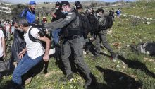 Israeli Border Police disperse Palestinian farmers and Israeli activists from a field threatened with confiscation, belonging to the village of Burin, Friday, February 12, 2021.