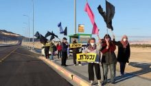 Anti-Netanyahu Black Flag protesters demonstrate near Ketura, a kibbutz located north of Eilat in the Arabah desert, Saturday, February 20, 2021.