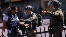 Israeli occupation soldiers confront Palestinian journalist