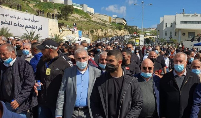 Among the thousands of protesters who took part in the Friday, March 4, rally in Umm al-Fahm were former Hadash MKs Mohammed Barakeh (first from right) the current head of the High Follow-Up Committee for Arab Citizens of Israel and Dr. Afo Agabria (second from right) presently the Chairman of Hadash.