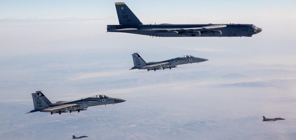 Israeli F-15 fighter jets escort an American B-52 bomber through Israeli airspace, Sunday, March 7, 2021.