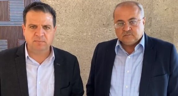Joint List's Ayman Odeh (Hadash) and Ahmad Tibi (Ta'al)after their meeting with Yesh Atid leader Yair Lapid in Tel Aviv, April 1, 2021