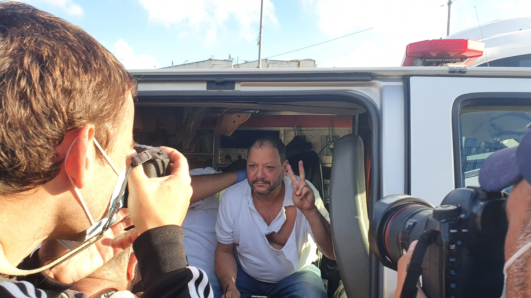 Joint List MK Ofer Cassif (Hadash) receives first aid treatment in an ambulance after being beaten by police officers during a protest in occupied East Jerusalem's Sheikh Jarrah neighborhood, Friday, April 9, 2021.