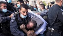 Joint List MK Ofer Cassif is violently restrained by police during the Friday, April 9 protest in occupied East Jerusalem's Sheikh Jarrah neighborhood.