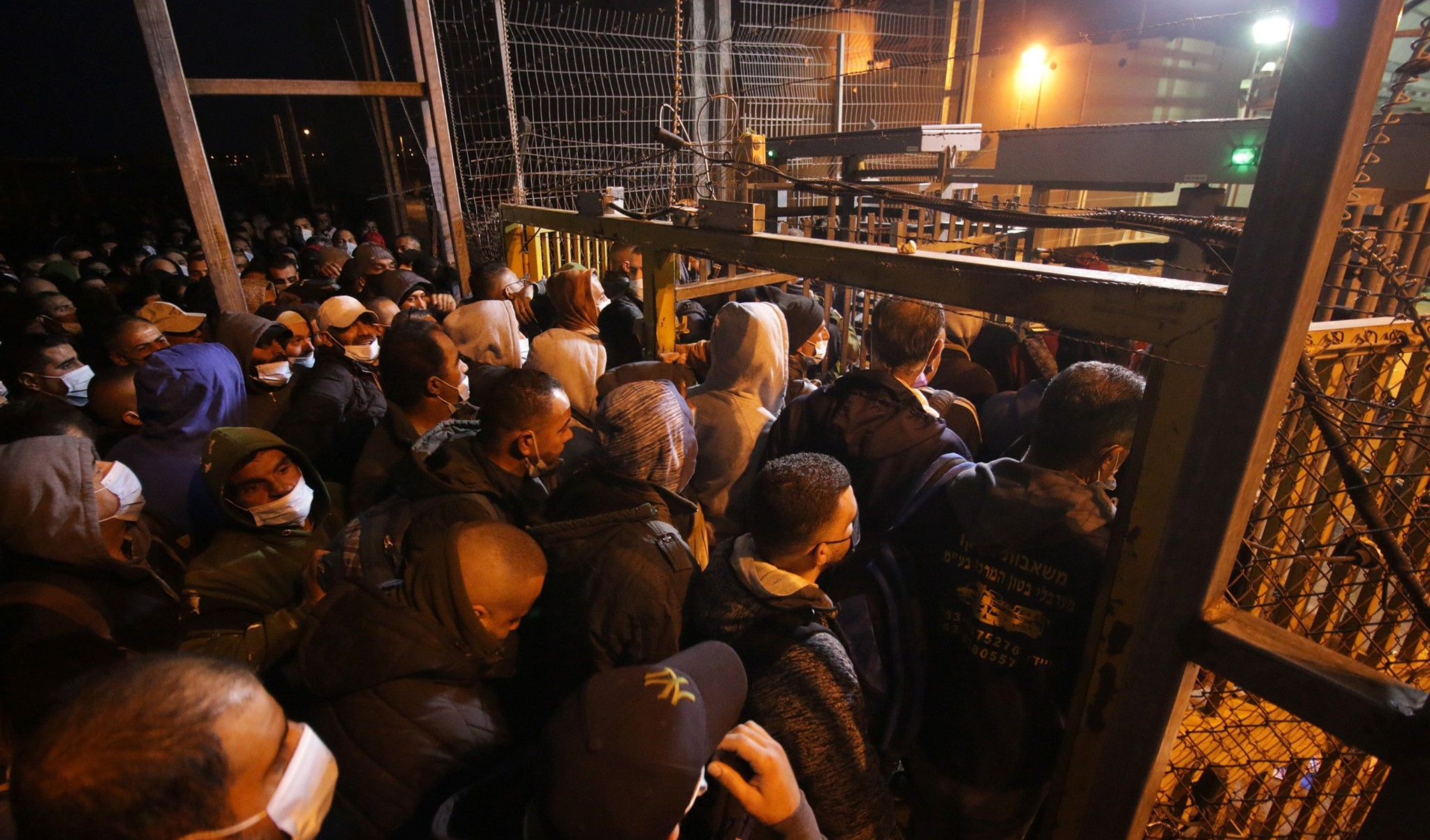 Thousands of Palestinian workers cross in the early morning hours every day through the Eyal checkpoint, near Qalqilya in the occupied territories, to reach their workplaces in Israel.