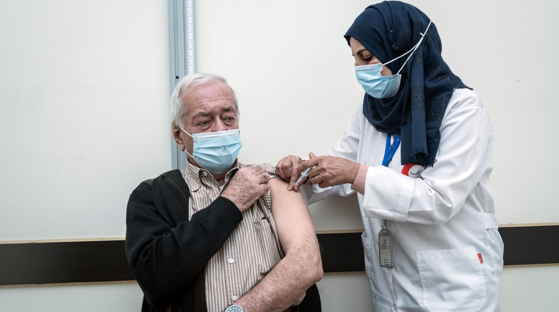A Palestinian resident of the West Bank receives a vaccination against COVID-19.