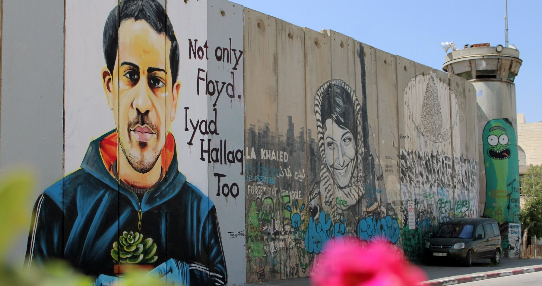 """Not only Floyd, Iyad Hallaq Too,"" a portrait of the 32-year-old autistic Palestinian man killed by Israeli police in occupied East Jerusalem in May 2020, rendered on Israel's ""Apartheid Wall"" separating Jerusalem and Bethlehem."
