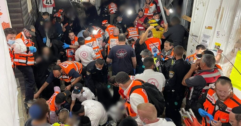 Rescue workers attempt to treat the injured following the disaster at Meron, Friday, April 30, 2021.