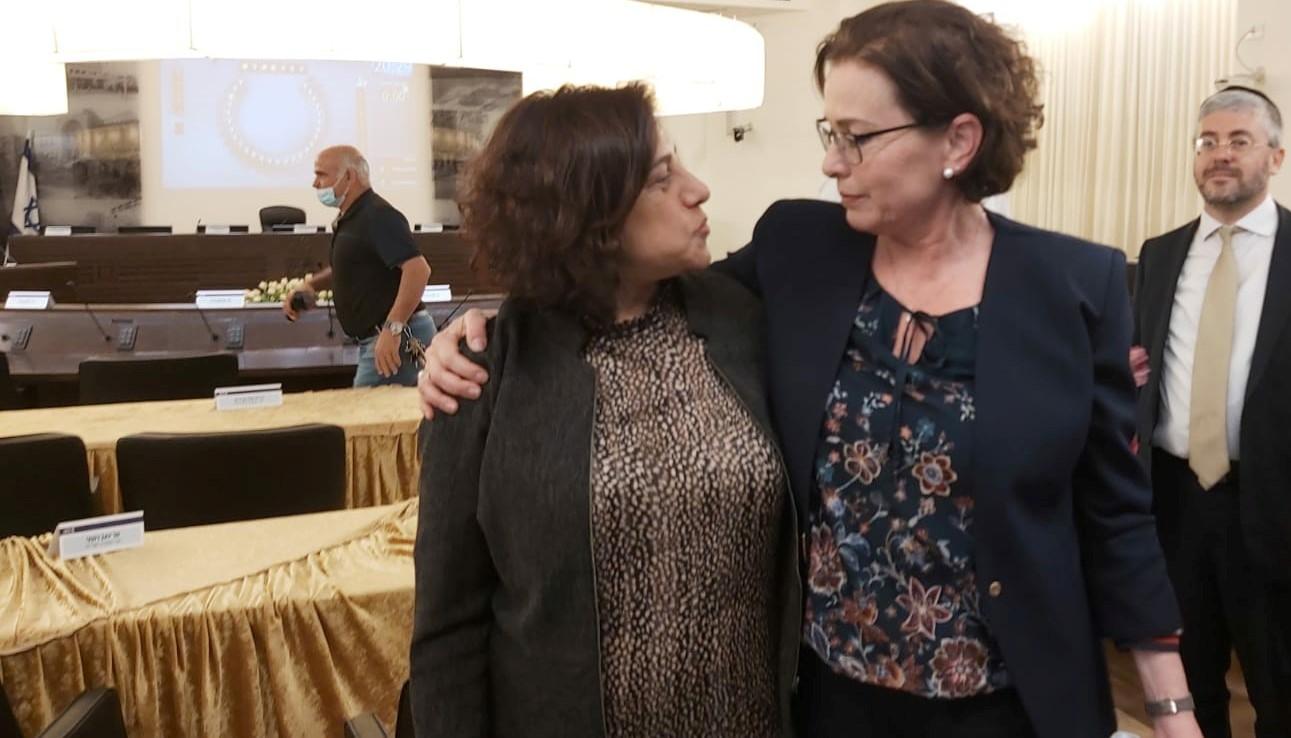 Shahira Shalabi (left), the new deputy mayor of Haifa, and Mayor Einat Kalisch-Rotem exhibit solidarity after a stormy city council meeting on Tuesday, May 4, 2021.