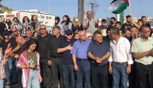 Protesters blocked traffic on a section of Route 65 on Saturday, May 8, near the northern city of Umm al-Fahm. Among them are former Hadash MKs Muhammad Barakeh and Youssef Jabareen.